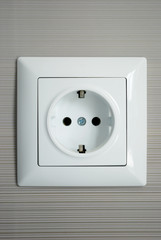 Electrical outlet installed on a gray background