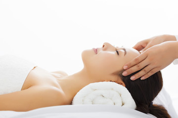 Young  woman getting spa treatment over white background