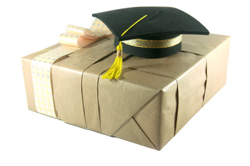 Graduation hat on   gift box a white background