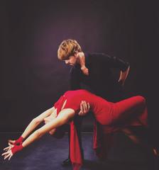 Beautiful couple dancing passionate dance