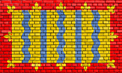 flag of Cambridgeshire painted on brick wall