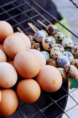Grilled chicken eggs on the stove at the market