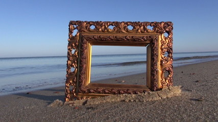 beautiful ancient ornate picture frame on sea resort beach