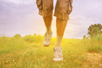 Man running on footpath in summer sunny day