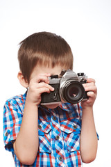 Little boy reporter photographer shooting with SLR camera isolat