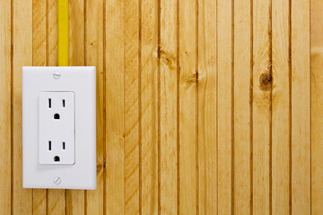 Outlet on a wooden wall