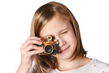 Girl photographer takes a picture retro camera isolated