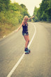 young woman posing with a skateboard