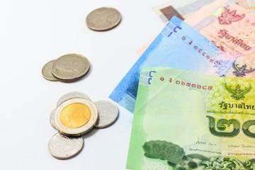 Heap of Thai baht Bills and coin