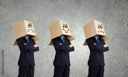 фBusiness people wearing boxes - 75190919
