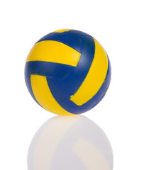 blue and yellow ball with reflection