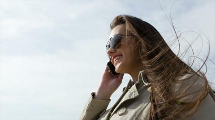 Beautiful blonde girl speaking on phone
