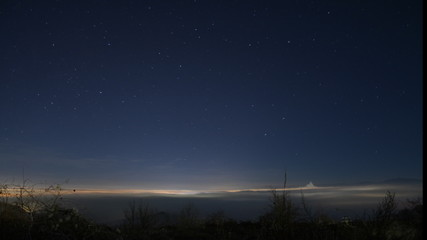 shooting stars above foggy city