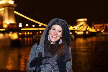Fashionable woman teeth smile at night