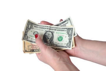 Dollar bill's in female hand's isolated on white background