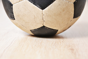 Detail of soccer ball on wooden background