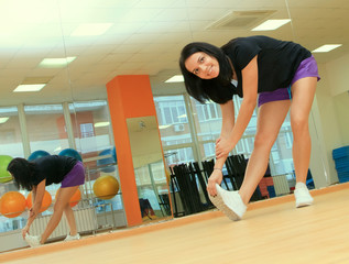 Young woman doing Fitness exercise in sport center