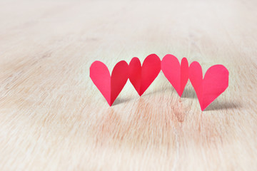 Paper hearts on wood
