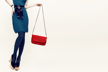 Glamorous lady in vintage trend accessories. Green and red combi
