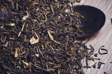 dried green tea leafs  on spoon