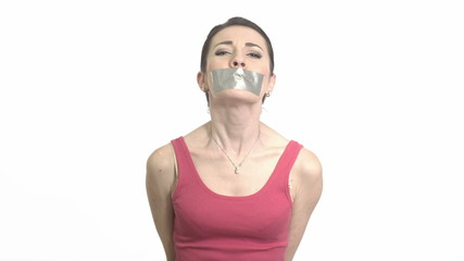 woman with gaffer tape on her mouth experiencing emotional pain