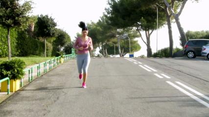 Woman jogging on street wide shot