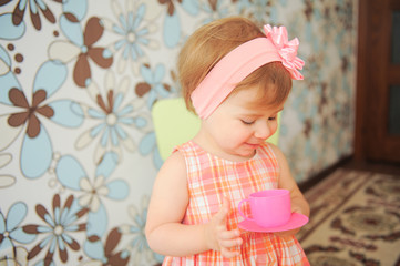 Girl with Pink Cup and Saucer