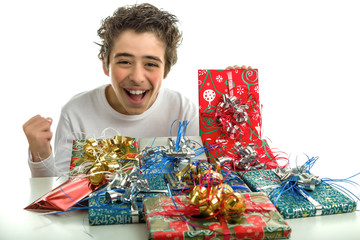 Happy boy smiles receiving Christmas gifts