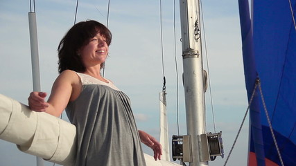 Happy smiling woman relaxing on sailboat, traveling, cruise