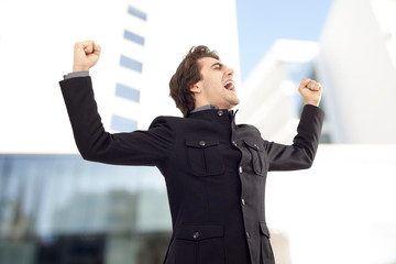 Businessmen with arms up celebrating his success