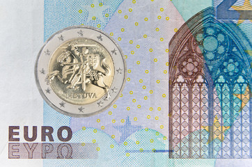 Lithuanian 2 eauro coin over banknote