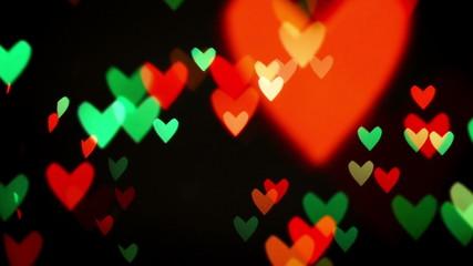 Colorful defocused blinking heart bokeh festive lights