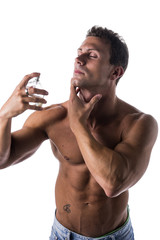 Shirtless muscular male model spraying cologne
