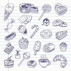 Freehand drawing sweetness items on a sheet of exercise book