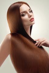 Brown Hair. Portrait of Beautiful Woman with Long Hair. High qua