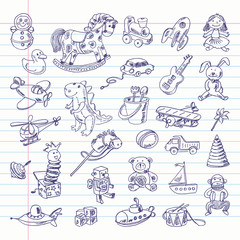 Freehand drawing retro toys items on a sheet of exercise book