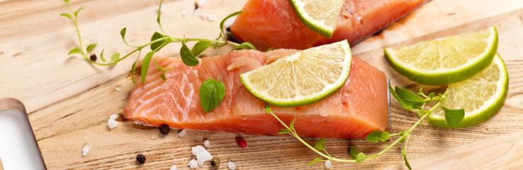 Fresh salmon fillet with oregano and lime slices