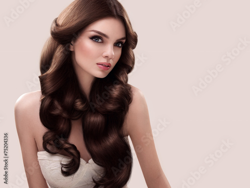 Hair. Portrait of Beautiful Woman with Long Wavy Hair. High qual Plakat