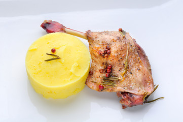 Oven-roasted duck legs and vegetables