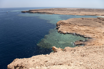 peaceful rock bay in the red sea region, sinai, egypt. tinted