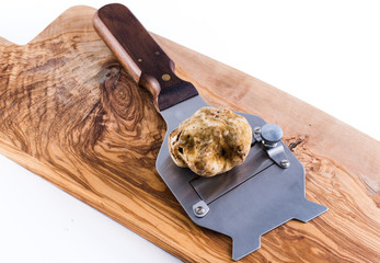 expensive white truffle from Alba and steel slicer