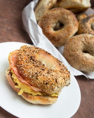 New York style breakfast bagel with scrambled eggs and ham