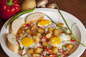 fried eggs including french bread,mushro,fried potato