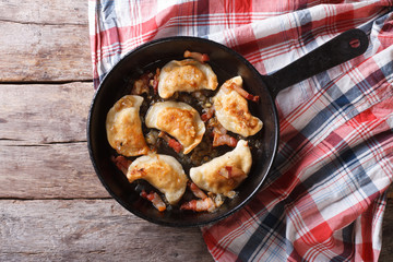fried dumplings with bacon in a pan horizontal top view