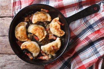 fried dumplings in a pan close-up. horizontal top view