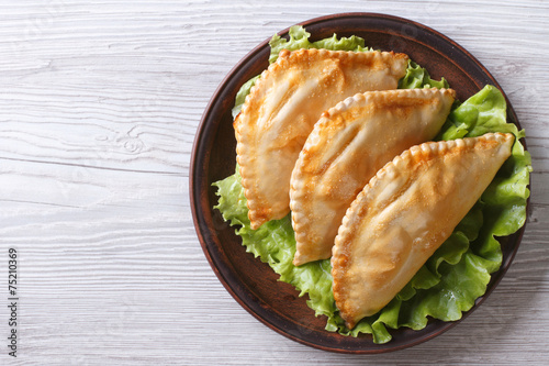Fotobehang Brood stuffed empanadas on a plate. horizontal view from above