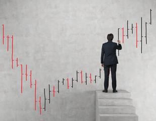 businessman drawing stock chart