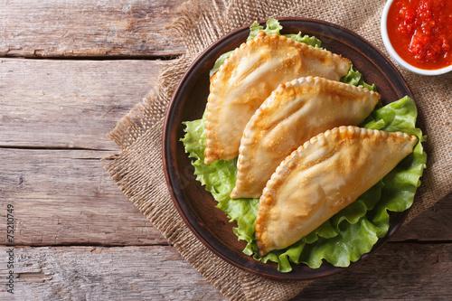 Fotobehang Brood Traditional empanadas and sauce closeup. horizontal top view