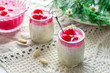 Rice pudding with almonds, whipped cream and cherry sauce