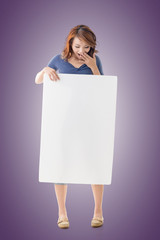 Excited Asian girl hold a blank board